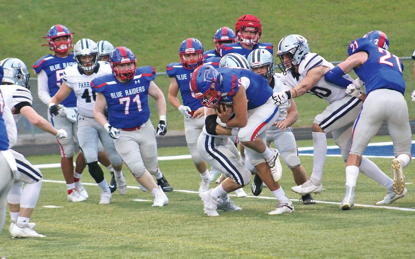CLEVELAND QUARTERBACK Drew Lambert (16) runs against Farragut in the Blue Raiders' win over the Admirals. Lambert and the Blue Raiders host the Walker Valley Mustangs Friday, at Benny Monroe Stadium.