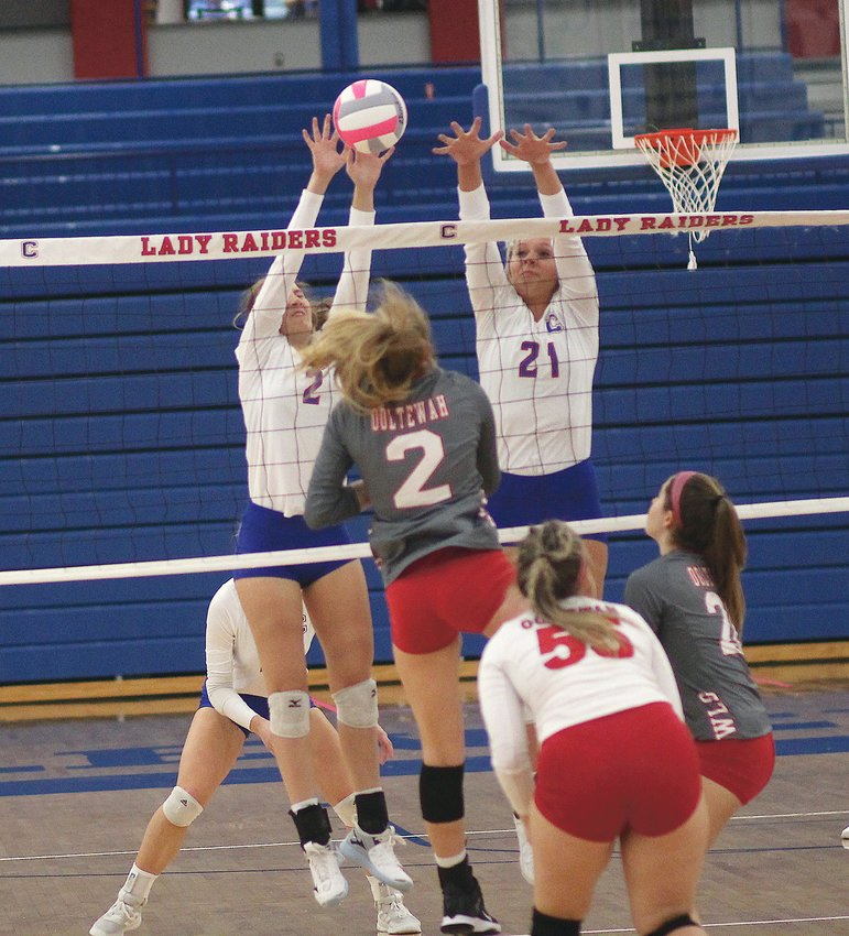 CLEVELAND HITTER Addison Hurst (24) sends a shot over the net against Ooltewah in the first set of a District 5-3A match Thursday, inside raider Arena.