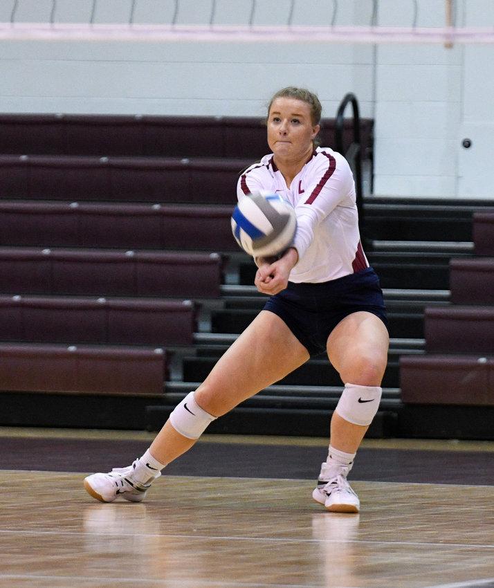 LADY FLAMES' SENIOR Hannah Longley had 15 digs in Tuesday's matchup at Emory.