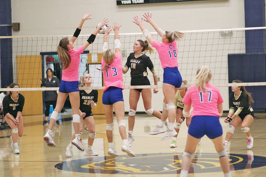 BRADLEY CENTRAL'S Trinity Reagan (19) lifts a shot up as Cleveland's Mary B. Smith, Lily O'Bryan (13) and Lauren Hurst attack the net during the District 5-3A volleyball championship Wednesday, at Walker Valley.