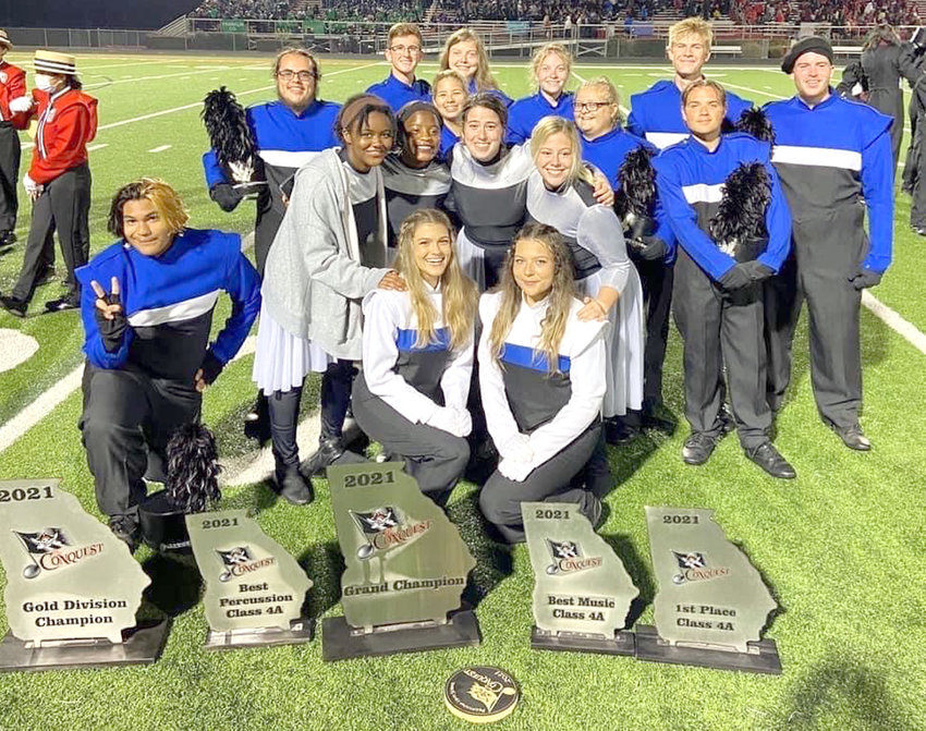 CHS MARCHING BAND seniors pose for a photo after collecting awards earned at a Sept. 25 invitational competition.