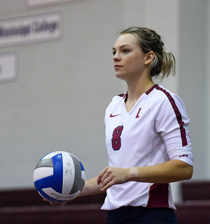 LEE . UNIVERSITY junior Mackenzie Pearson prepares to serve during volleyball action over the weekend at Walker Arena.