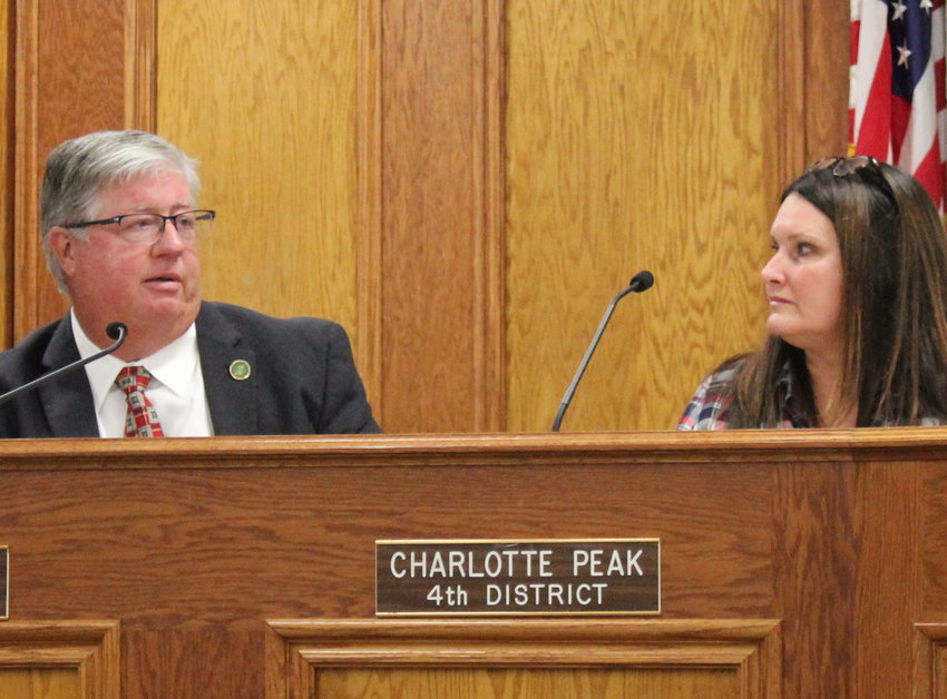 BRADLEY COUNTY Commissioner Charlotte Peak listens as Commissioner Milan Blake addresses taking discussion of whether recent retirees should be eligible for essential worker premium pay bonuses. The issue of bonuses was discussed at length during Monday's commission meeting.
