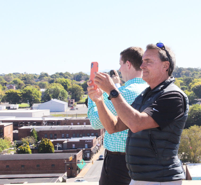 TIM HENDERSON, president and chief executive officer of Cleveland Utilities, takes a photo from atop the old Cherokee Hotel. MainStreet Cleveland members and Cleveland city officials toured the historic old landmark Monday to get a good look at its potential for redevelopment into a vibrant part of downtown Cleveland.