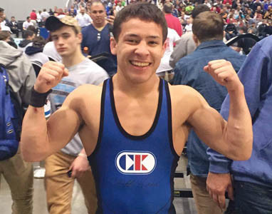 FOUR-TIME state champion Chris DeBien celebrates after winning a national championship at the NHSCA Nationals on Sunday, in Virginia Beach, Va.