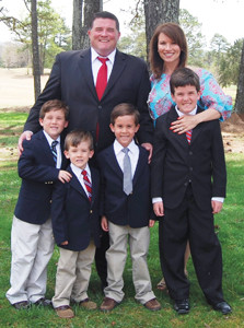 SISSY FIGLESTAHLER, is shown with her growing family. She and her husband, Andy, are shown during the Easter holidays with sons, Patrick, 4,  John Peter, 6, Jack, 8, and Andrew, 10.
