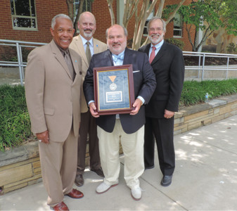 OFFICIALS gather with businessman Allan Jones as he receives an award for his philanthropy. From left are Tennessee Board of Regents member Howard Roddy, Cleveland State Community College President Dr. Bill Seymour, Jones and TBR Chancellor John Morgan.