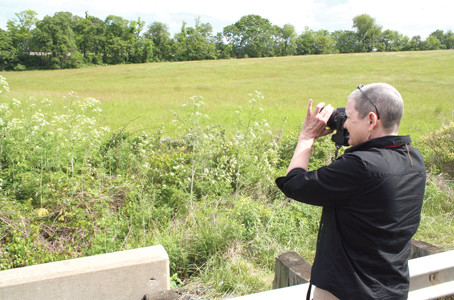 Cleveland historian Debbie Moore photographs the spot where the Thaxton, Va., train wreck of 1889 occurred.