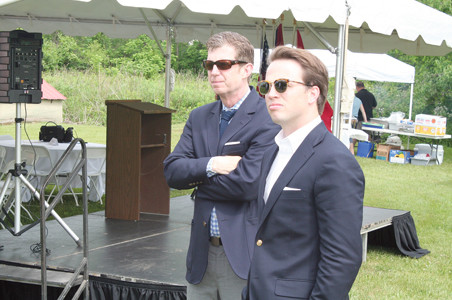 Tommy Hopper, great-nephew of John Hardwick who was killed in the Thaxton, Va., train wreck, watches the ceremonies with Will Jones, son of Allan Jones whose foundation sponsored the historic marker