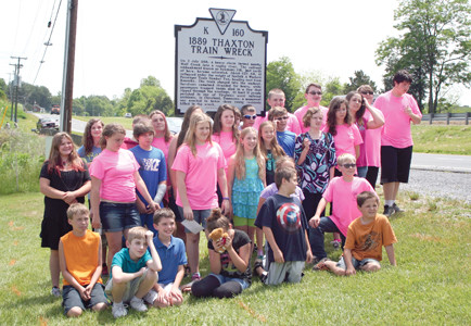 Thaxton Elementary School students pose by the new historic marker in Thaxton, Va.