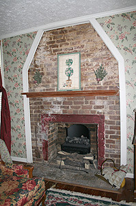 THIS ORIGINAL brick fireplace was uncovered from behind a wall built by a previous owner.