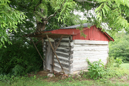 AN OUTBUILDING, possibly once used as a slave quarters, still sits behind the Pinhook Plantation house.
