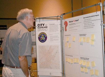 "ROTARIAN DAVID CHAFFIN reviews comments left at the ""Cleveland: Exploring Our Future"" exhibit during Tuesday's meeting."