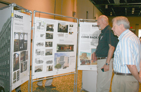 ROTARIANS BILL SEYMOUR and Jim Buckner look at designs for converting The Cleveland Summit back to the Cherokee Hotel.