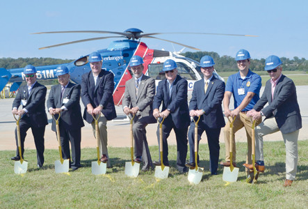 GROUNDBREAKING CEREMONIES were held Monday at the Cleveland Regional Jetport for the Life Force medical helicopter hangar. With the helicopter in the background are, from right: Scott Carroll with Med-Trans; Derek Ball, Life Force base manager; Rob Brooks of Erlanger; Lou Patten, Cleveland Municipal Airport Authority chair; Bradley County Mayor D. Gary Davis; Mark Fidler, director of operations, Cleveland Regional Jetport; Joe Winick of Erlanger; and Robbie Tester, Life Force administrator.