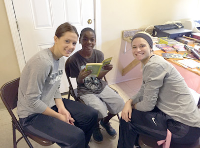 "Student-athlete Kaylan Withrow ""Make a Difference"" for Montgomery kids during a reading program on Make A Difference Day."