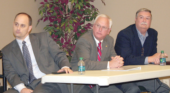 John Hatfield of Voiceopia, Cleveland Utilities CEO Ken Webb, and EPB CEO Harold DePriest listen to comments at the recent Chamber broadband forum.
