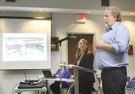LEWIS GROUP ARCHITECTS representatives Douglas Shover and Lauren Bush present designs for a new Lake Forest Middle School building to members of the Bradley County Board of Education during its Thursday night meeting.