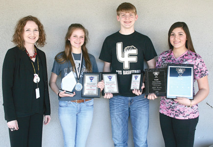 LAKE FOREST MIDDLE SCHOOL'S student government association recently received several state awards for its community service efforts. From left are LFMS Assistant Principal Carissa Sapp, student body president Gabrielle Bennett, SGA member Dakota Davis and student body vice president Hannah Deal.