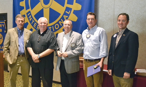 THREE PAUL HARRIS FELLOWS were introduced at the Rotary Club of Cleveland meeting Tuesday. From left are Rotarian Tom Thomas; Paul Harris Fellows Dwight Richardson, Bill George and Jordy Waller; and Rotary Club President Nicholas Lillios.