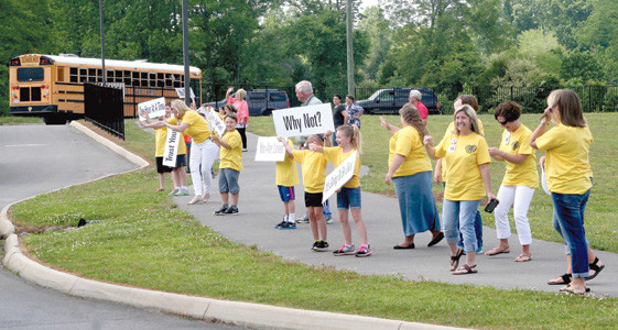 PARK VIEW ELEMENTARY SCHOOL students, teachers and parents wave to passers-by while taking part in the Happiness Sprinkling Project, a national effort to spread positivity in public places.