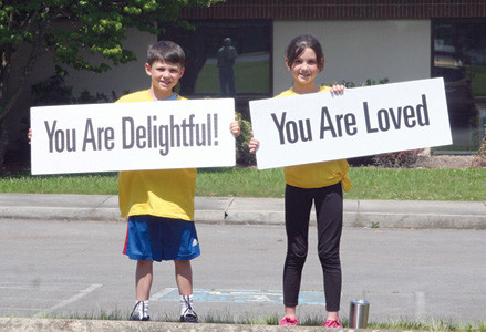 "ANDREW AND EMILY NEWMAN were among the smiling students from Park View Elementary School ""sprinkling happiness"" on passers-by after school Tuesday."