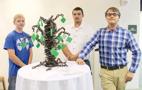 FAUX FILTERS and chains were among the materials three Bradley Central High School students used to create a sculpture model for catalyst manufacturer Cormetech. From left are Joseph Rymer, Matthew Sanford and Matthew Robinson.