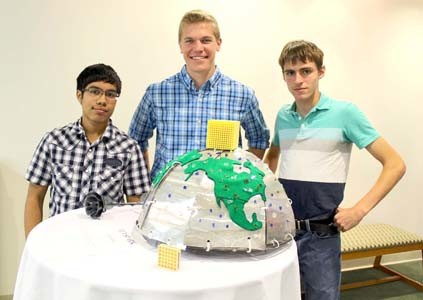 A WORLD made cleaner by catalyst filters was the thought behind a Cormetech-themed sculpture by three Bradley Central High School students. From left are Alejandro Suarez, Stephen May and Jonathan York.