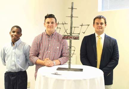 JAPANESE WORDS from the mission statement of automotive parts manufacturer Denso were part of a sculpture designed and built by three Walker Valley High School students. From left are Garrett Robinson, Corbin Day and Matthew Stuckey.