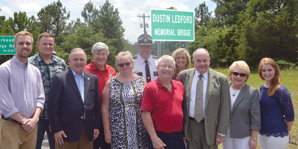 THE BRIDGE AT APD 40 at 20th Street was dedicated to the memory of Dustin Ledford, with many dignitaries in attendance. From left are Matt O'Brien of the District Attorney General's Office; Tony Cameron, the first officer on the scene of the fatal accident; State legislators Kevin Brooks and Todd Gardenhire; Kim Ledford, Dustin's mother; Bradley County Sheriff Eric Watson; Danny Ledford, Dustin's father; Tennille Watson; Mayor Tom Rowland and his wife, Sandra, and Kate Ritchie of Mothers Against Drunk Driving.