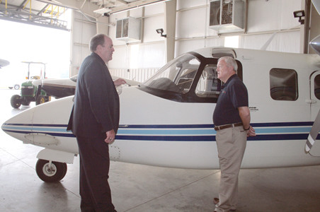 CLEVELAND REGIONAL JETPORT director Mark Fidler talks with Cleveland Municipal Airport Authority chair Lou Patten in the maintenance hangar during a tour.