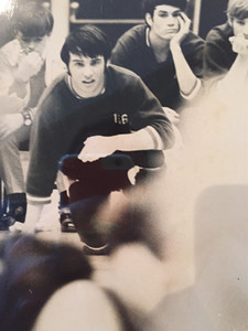 Local businessman Allan Jones, right, is seen above during his wrestling days at Cleveland High School. Jones will be honored next month by the National Wrestling Hall of Fame.
