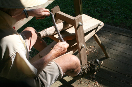 THIS SHAVING HORSE was used when a piece of wood needed to be rounded out and made smooth, according to Tom Newman, who can actually work the handmade tools to make furniture.