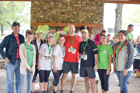 A TEAM OF RUNNERS from Lee University last year paced their way into first place in Junior Achievement of the Ocoee Region's 5K Race to Achieve. Some of the Lee University representatives included Vanessa Hammond, Kendra Gray, Kristi Vanoy, Dr. Shane Griffith and Dr. Jared Wielfaert. Also pictured, left, is Alex Starling, general manager of Publix, as well other Publix representatives. The grocer this year is serving as presenting sponsor of the event. Melanie Connatser, second from right, is JA president. This year's event is Aug. 27.