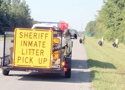 Inmates from the Bradley County Justice Center pick up litter along APD 40.