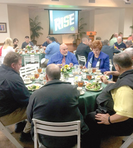 SUPPORTERS of FCA of the Ocoee Region chat with each other during a recent luncheon. The organization has started an adult chapter to involve community members in the ministry for coaches and students in local schools.