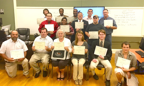 THE LATEST GRADUATES of the local nonprofit organization The Refuge's Career Connection program show off their completion certificates. Another class started last week, and yet another is set to start in October.
