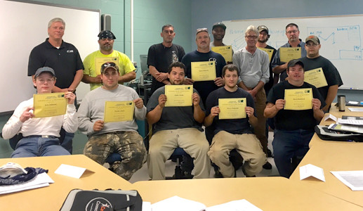 THE FIRST STUDENTS taking advantage of a welding course at Cleveland State Community College offered to graduates of local nonprofit The Refuge's Career Connection program show off their completion certificates.