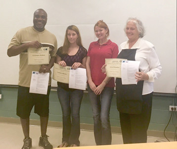 BRE LaMOUNTAIN of Cleveland State Community College, second from right, congratulates three graduates of The Refuge's Career Connection program who received customer service training at the college. From left are Christopher Brabson, Leanna Ledbetter, LaMountain and Teresa Barganier.