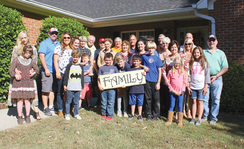 FAMILY MEMBERS gather for one of their first photos together. After Utah resident Jack Marvell learned he had family in Tennessee while searching for his father's identity, they arranged a meeting. He and 12 of his relatives recently traveled cross-country to visit with some of their newfound relatives in Bradley County.