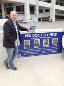 "LIKE HIS DAD, Bill Mull, and grandfather ""Red"" Dockery, before him, Johnny Mull played football for Bradley Central in the late 1970s. In this photo, he is at the dedication of the Liberty Bowl football field in memory of his uncle ""Rex"" Dockery, who was the head coach at Memphis State University when he was killed in a plane crash on Dec. 12, 1983"