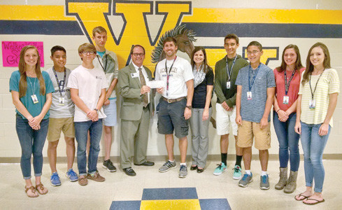 JUNIOR ACHIEVEMENT of the Ocoee Region enjoyed another successful 5K Race to Achieve which was held recently for the third consecutive year, and the Walker Valley High School track team came away with $250 in prize money from First Tennessee Bank. From left are WVHS participants Bailey Mullett, James Jur, Tyler Ramage and Eric Brehen; Mike Griffin of First Tennessee Bank; coach Drew Nunnelly; Melanie Connatser, JA president; and WVHS participants Sean Mullett, Arthur Jur, Cassidy Balkom and Ashtyn Frazier. Not pictured is John Hixon, senior captain.