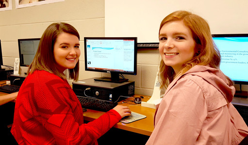 TAYLOR HOLCOMB AND MADISON WILLIAMS practice their Microsoft Office skills in a computer applications class at Walker Valley High School.