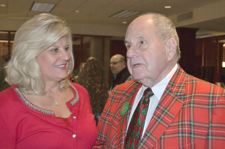 MAINSTREET CLEVELAND Executive Director Sharon Marr speaks with Cleveland Mayor Tom Rowland during the MainStreet Cleveland Christmas party at Bank of Cleveland Wednesday evening.