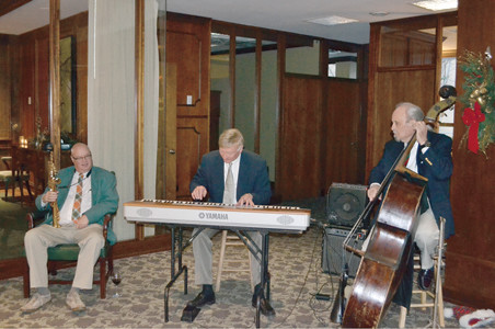 THE WALTER MEYER TRIO provided musical entertainment at the MainStreet Cleveland Christmas party.