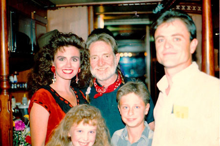 She also posed with singer Willie Nelson on his tour bus in 1994 after one of his concerts. They were joined by her husband, Rodney, and their children, Ray-Allen and Shereé.