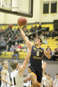 WALKER VALLEY JUNIOR Kolten Gibson eyes the basket during tournament action against North Murray County (Ga.), Tuesday, in Chatsworth, Ga.