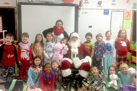 KRISTY STEWART'S first-grade class at Hopewell Elementary School recently received a special visit from Santa Claus. In the second row, from left, are Drew Albritton, Jonas Prichard, Maddi Koenig, Gwyneth Miller, Mae Emendorfer, Santa Claus, Malik Ortiz-Redd, Drake Patterson, Savannah O'Connell and Katie Neely. In the front row are Kinley Price, Alex Lopez, Vincent Braswell, Lindsay Payne and Katie Tanksley. Stewart is standing in back.