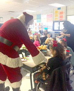 SANTA CLAUS interacts with some of the good boys and girls attending Hopewell Elementary School. His visit provided a bit of extra cheer before school let out for the holidays.