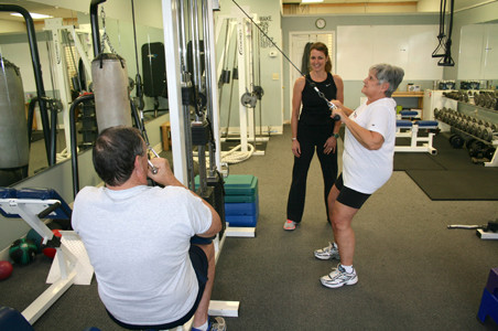 David and Ellen Smith, left and right, prefer the privacy of working out with an exclusive personal trainer to bring out their personal best.